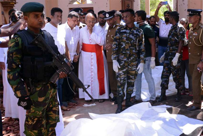 Cardinal Malcolm Ranjith of Colombo, Sri Lanka, looks at the explosion site inside a church in Negombo April 21, 2019, following a string of suicide bomb attacks on churches and luxury hotels across the island. Cardinal Ranjith has finally won a concession from Sri Lanka's government after widespread criticism of the investigation into the deadly attacks.