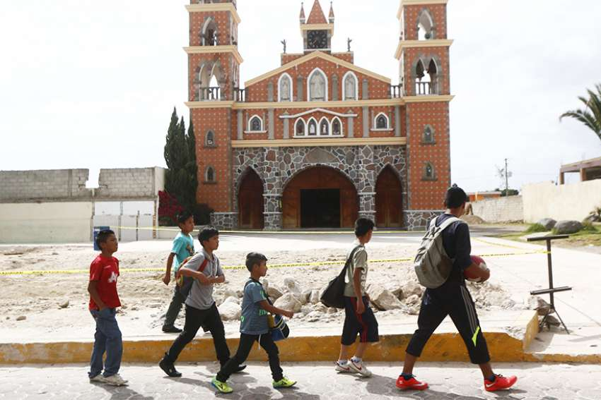 Children walk past a church in the Mexican state of Tlaxcala in this 2015 file photo.