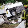 A firefighter walks amid the wreckage of a bus that crashed near the town of Avellino in southern Italy July 29. At least 38 people died when the bus filled with pilgrims returning from a Catholic shrine tour plunged off an elevated highway.