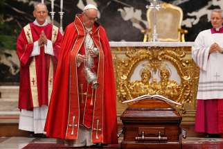 Pope Francis uses holy water to bless the casket of French Cardinal Jean-Louis Tauran during his funeral Mass in St. Peter's Basilica at the Vatican July 12. Cardinal Tauran, who announced the election of Pope Francis, had a long career as a Vatican diplomat and later worked on interreligious dialogue. He died July 5 at the age of 75 in Hartford, Conn.