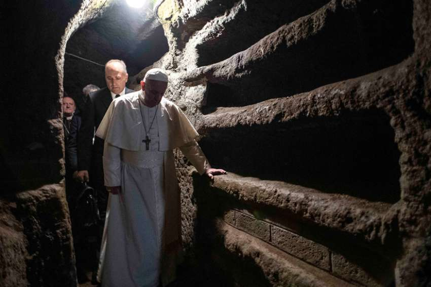 Pope Francis walks through the Catacombs of Priscilla where he celebrated Mass in Rome Nov. 2, 2019, the feast of All Souls.