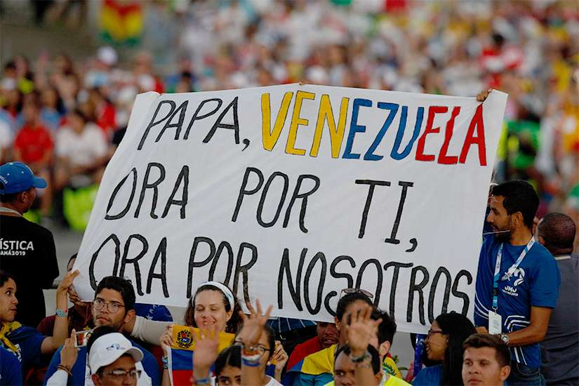 A sign calls attention to Venezuela as Pope Francis leads the World Youth Day prayer vigil at St. John Paul II Field in Panama City Jan. 26, 2019.