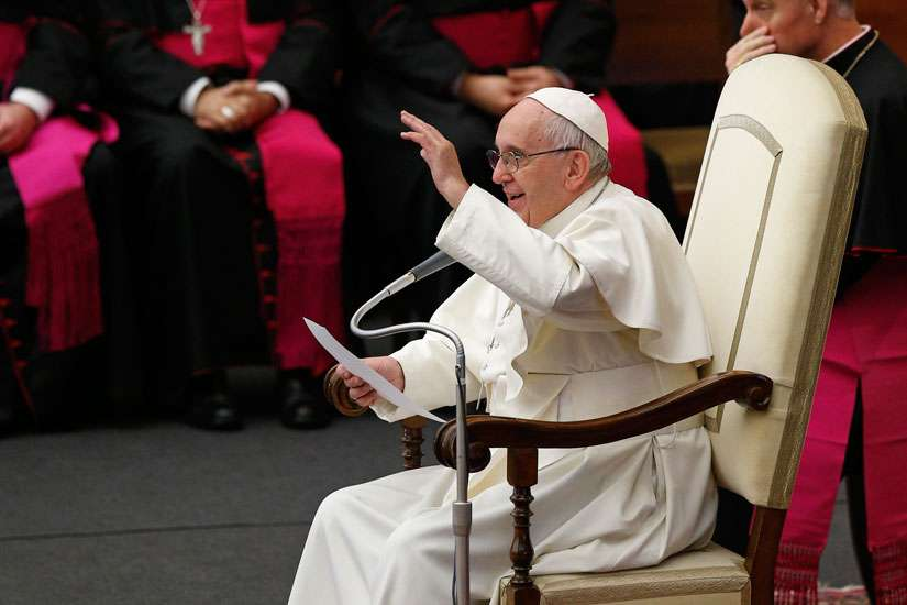 Pope Francis gestures during his general audience in Paul VI hall at the Vatican Dec. 14.