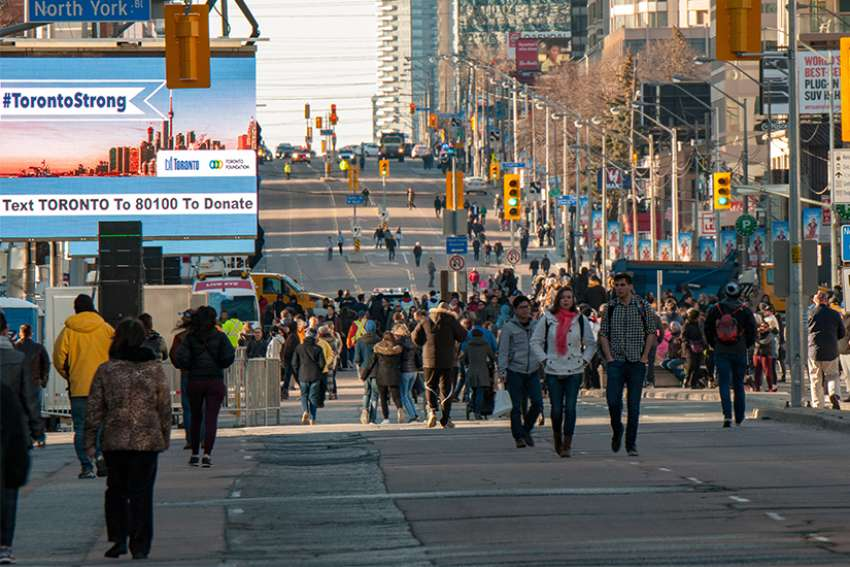 Torontonians 'take back' the stretch of Yonge Street near Mel Lastman Square where a van attack killed 10 and injured 15 in Toronto.