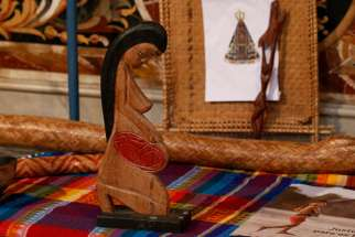 A wooden statue of a pregnant woman is pictured in the Church of St. Mary in Traspontina as part of exhibits on the Amazon region during the Synod of Bishops for the Amazon in Rome Oct. 18, 2019. Several copies of the statue were stolen from the church and thrown into the Tiber River Oct. 21.