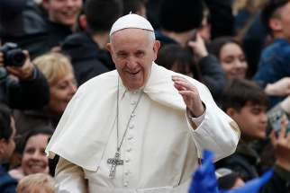 Pope Francis greets the crowd during his general audience in St. Peter's Square at the Vatican April 11.
