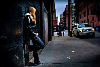 Photo illustration of a young woman depicts the effects of human trafficking. Robert Kinghorn writes that the good news of the Church on the Street is not reported alongside the murders and the overdoses in secular newspapers.
