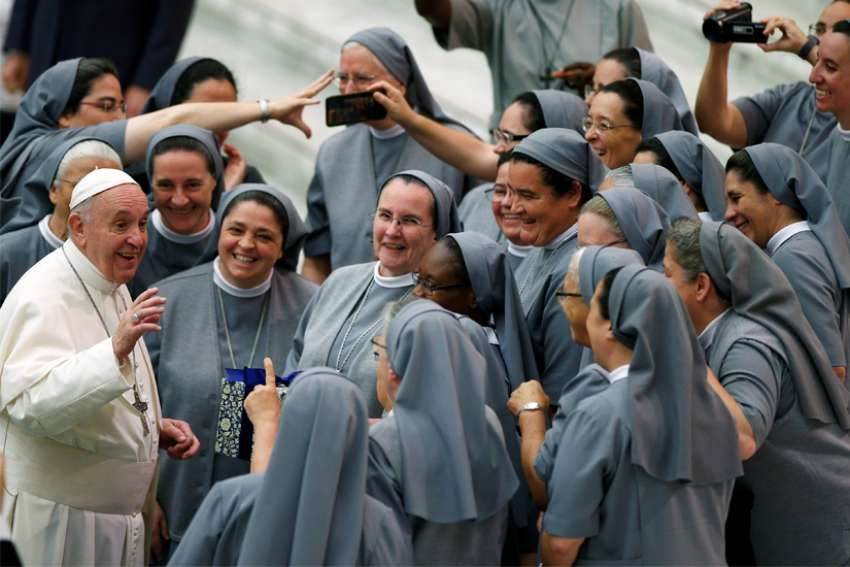 Pope Francis greets a group of women religious as he arrives for his general audience in Paul VI hall at the Vatican.