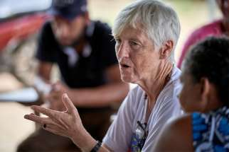 "U.S. Sister Kathryn ""Katy"" Webster, a member of the Sisters of Notre Dame de Namur from the United States, talks with farmers in the countryside near Anapu, in Brazil's northern Para state."