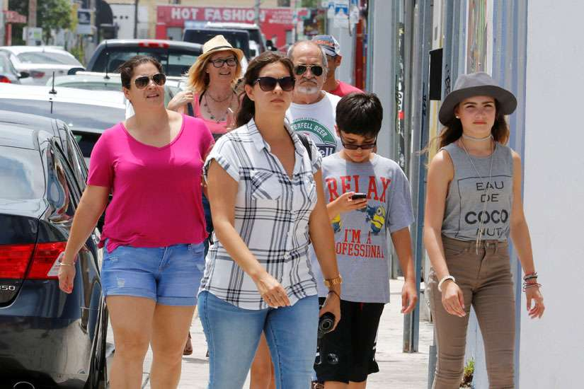 Visitors walk through the Wynwood arts district of Miami Aug. 3. During the first week of August, the Florida Department of Health reported its 16th case of locally transmitted Zika virus in a one-square-mile area of Miami north of downtown, bringing the total number of people infected in the mosquito-borne outbreak to at least 16