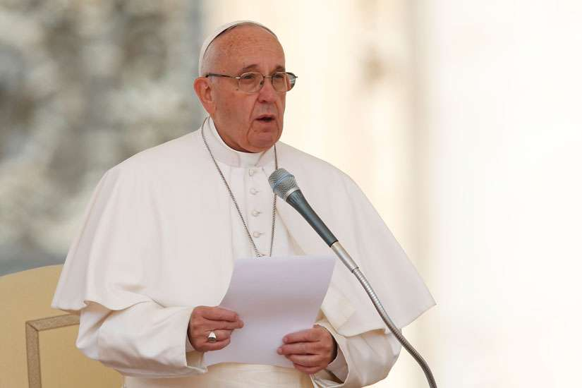 Pope Francis calls for prayers for victims of recent terrorist attacks in Syria as he reads a statement during his general audience in St. Peter's Square at the Vatican May 25.