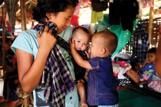 A displaced ethnic Kachin family is seen in early May at a temporary camp on the grounds of a Catholic church in Myitkyina, Myanmar. Myanmar's military still is persecuting ethnic Kachin, the predominant Christian group in a conflict-torn part of the country, as well as Rohingya Muslims, Cardinal Charles Maung Bo of Yangon said.