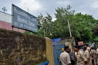 Indian police stand outside the premises of the Missionaries of Charity home in Ranchi, where Sister Concilia was arrested July 5, 2018, on suspicion of child trafficking. On Jan. 29 the Indian Supreme Court rejected bail for the nun, who has not yet been charged.