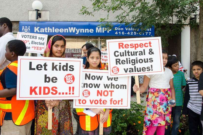 More than 100 concern citizens gathered outside Kathleen Wynne's office on Sept. 2 to once again protest the pending implantation of the controversial revisions to the sexual education curriculum. Photo by Evan Boudreau.