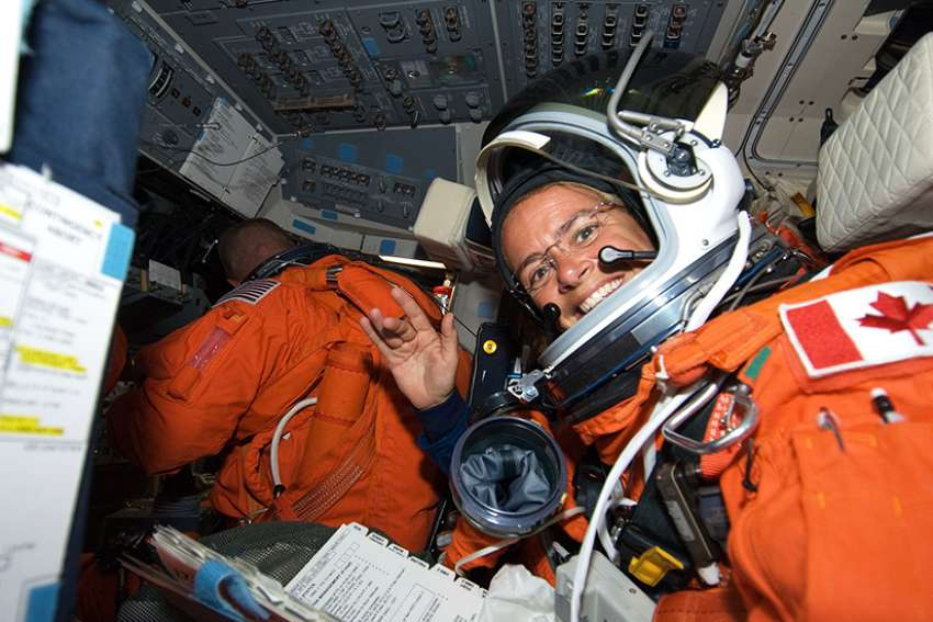 Julie Payette, STS-127 mission specialist, attired in her shuttle launch and entry suit, on the flight deck of Space Shuttle Endeavour during postlaunch activities in July 2009.