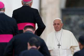 Pope Francis prepares to meet bishops during his general audience in St. Peter's Square at the Vatican Sept. 19.
