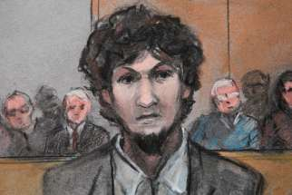 In this courtroom sketch, convicted Boston Marathon bomber Dzokhar Tsarnaev stands as he is sentenced to death at the U.S. courthouse in Boston May 15.