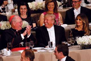 Donald Trump and New York Cardinal Timothy Dolan share a laugh during the 71st annual Alfred E. Smith Memorial Foundation Dinner in New York City in 2016.