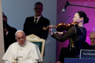 Pope Francis watches as violinist Midori performs at a meeting of the governing council of the International Fund for Agricultural Development at the headquarters of the U.N. Food and Agriculture Organization in Rome Feb. 14, 2019.
