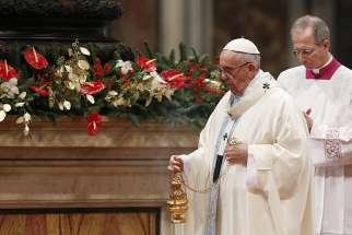Pope Francis uses incense during a Mass marking the feast of Mary, Mother of God, in St. Peter's Basilica at the Vatican Jan. 1.