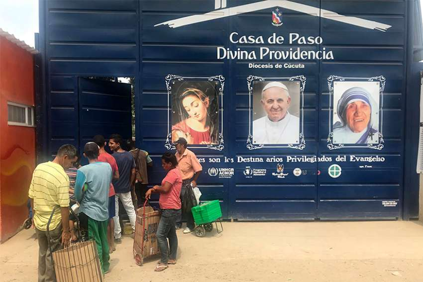 Migrants line up outside the Divine Providence Soup Kitchen in Cucuta Colombia, Feb. 9, 2019. For the past few years, church groups have been calling on Venezuelan President Nicolas Maduro to let humanitarian aid into the country, to relieve the suffering of millions of vulnerable Venezuelans.