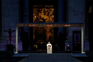 "Pope Francis leads a prayer service in an empty St. Peter's Square at the Vatican March 27, 2020. At the conclusion of the service the pope held the Eucharist as he gave an extraordinary blessing ""urbi et orbi"" (to the city and the world). The service was livestreamed in the midst of the coronavirus pandemic."