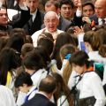 Youths surround Pope Francis as he meets with students from Jesuit schools June 7 in Paul VI hall at the Vatican.