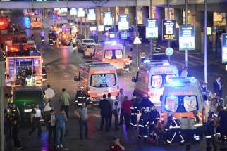 Paramedics help people outside Istanbul's Ataturk Airport following a June 28 suicide attack. The bombings killed over 40 and wounded more than 230 as Turkish officials blamed the carnage at the international terminal on three suspected Islamic State group militants.
