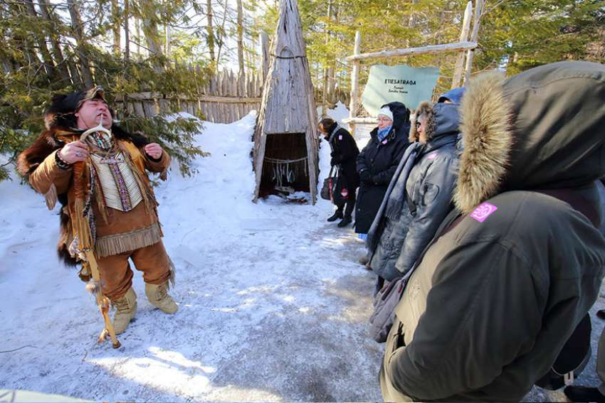 Huron-Wendat guide Simon Perusse explains how his nation prepared food during a March 10 meeting with members of the Canadian Religious Conference in Wendake, Quebec.