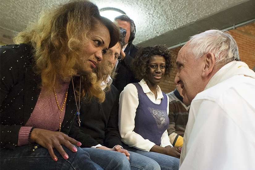 Pope Francis washes the foot of a female inmate during the Holy Thursday Mass in 2015 at Rebibbia prison in Rome.