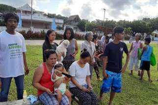 People gather on a field after twin earthquakes struck Batanes province on the northernmost island of the Philippines, July 27, 2019. Bishop Danilo Ulep of the Batanes prelature has appealed for prayers and help for victims of the disaster.