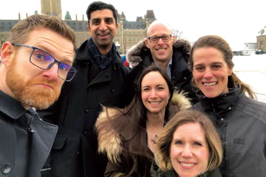 Sara Francis, centre, joins her fellow CCO alumni for a wintery walk around Ottawa.