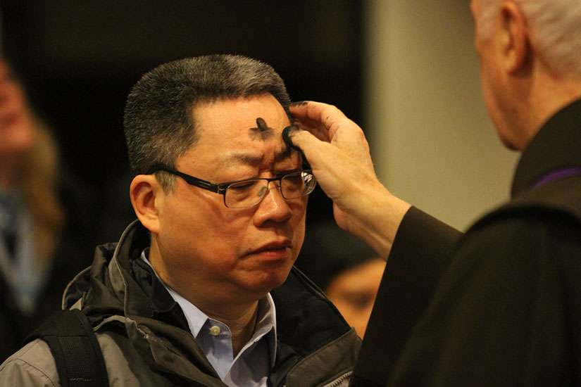 A man receives ashes on Ash Wednesday at St. Francis of Assisi Church in New York in 2014.