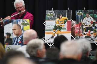 A musician performs during an April 8 vigil at Elgar Petersen Arena in Humboldt, Saskatchewan, to honour members of the Humboldt Broncos junior hockey team who were killed in a bus accident.