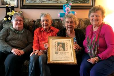 George and Olive Heron sit between two of their daughters, Susan, left, and Janice, who can also boast of long marriages. The Herons are holding a certificate they received from St. Pope John Paul II on the occasion of their 50th wedding anniversary 21 years ago.