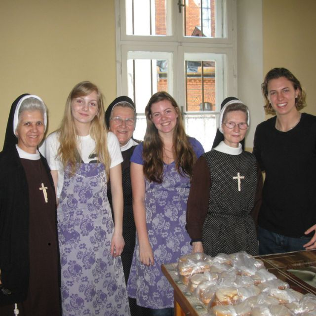 From left to right, Sr. Alina Ploszczyca, Provincial Minister of the Krakow Province, student Jessica Pelletier, Sr. Mary Archangela Bojarczuk, a Felician sister from Toronto who accompanied the group, student Victoria Smirlies, an unidentified Felician sister from Poland and student Kamila Swiderski stand in the soup kitchen in Krakow.