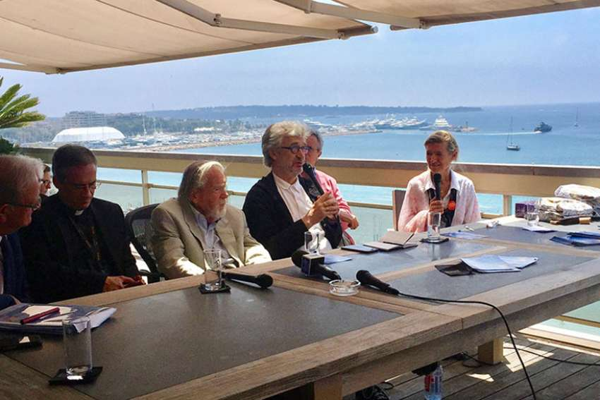 German director Wim Wenders, center, speaks during a panel discussion on May 25, 2017, in Cannes, France.