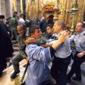 Israeli police officers scuffle with a member of the Armenian clergy in the Church of the Holy Sepulchre in Jerusalem in 2008. Ancient animosities are not uncommon in Jerusalem, even at holy sites.