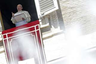 Pope Francis leads the Angelus from the window of his studio overlooking St. Peter's Square at the Vatican Aug. 30.