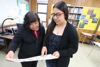 Aylin, a ninth-grader at La Salle Prep in Milwaukie, Ore., shares a recent school project in late May with her mother, Luz, who emigrated from Mexico.