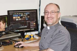 Fr. Darryl Millette in his Saskapriest studio in Saskatoon.