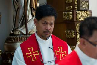 Father Edwin Gariguez, secretary-general of the National Secretariat for Social Action Caritas Philippines, is pictured in Manila Feb. 3, 2014.