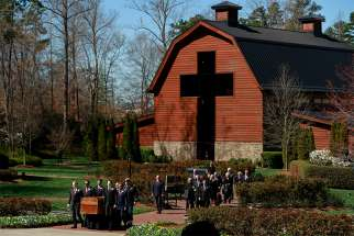 Pallbearers carry the Rev. Billy Graham's casket during his funeral service in Charlotte, N.C., March 2.