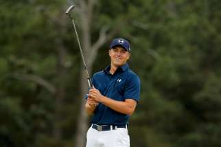 U.S. golfer Jordan Spieth smiles April 12 after sinking his putt on the 18th hole to win the Masters golf tournament at Augusta National Golf Course in Georgia. The 21-year-old golfer attended St. Monica's Catholic School in Dallas and graduated in 2011 from Jesuit College Prep in Dallas.