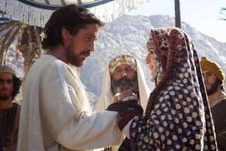 "Christian Bale, Kevork Mailkyan, center, and Maria Valverde star in a scene from the movie ""Exodus: Gods and Men."" The Catholic News Service classification is A-III -- adults. The Motion Picture Association of America rating is PG-13 -- parents strongly cautioned. Some material may be inappropriate for children under 13."