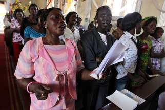 South Sudanese Catholics pray during Mass in 2011 at a church in Juba. Pope Francis has donated about $500,000 dollars to church charities in the violence-afflicted country to show solidarity.