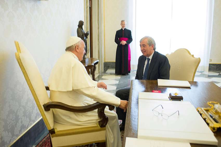 Pope Francis meets Libero Milone, then the Vatican's auditor general, at the Vatican April 1, 2016.
