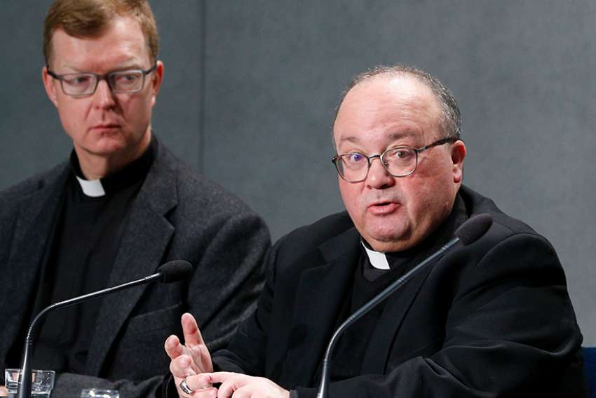 Jesuit Father Hans Zollner and Archbishop Charles J. Scicluna of Malta, members of the organizing committee for the Feb. 21-24 Vatican meeting on the protection of minors in the church, lead a press conference to preview the meeting at the Vatican Feb. 18, 2019.