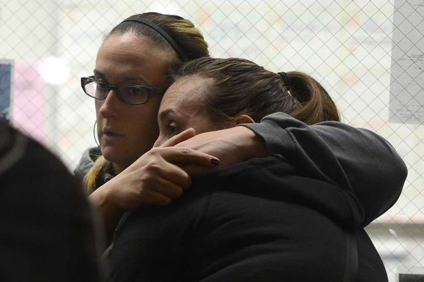 Evacuees from the scene of a shooting at the Inland Regional Center embrace Dec. 2 as they wait inside the Rudy C Hernandez Community Center in San Bernardino, Calif. At least 14 people were reported killed and more than a dozen injured when gunmen opened fire during a function at a center for people with developmental disabilities, police said.
