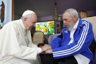 Pope Francis and former Cuban President Fidel Castro hold hands at Castro's residence in Havana Sept. 20, 2015. A new documentary, premiered Sept. 8, chronicle's the Pope's 2015 visit.